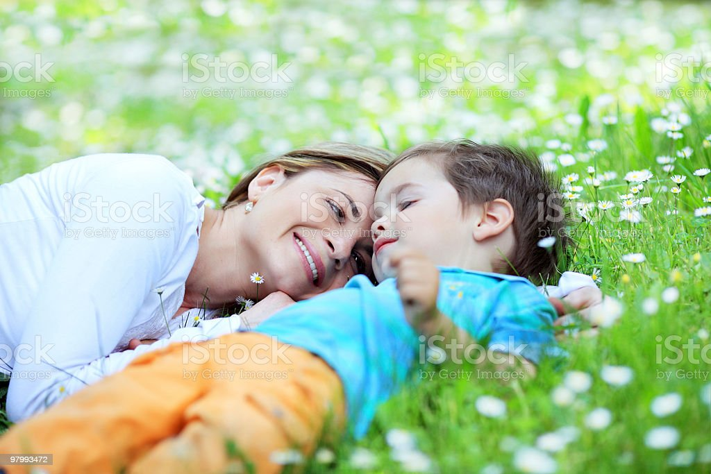 Mother with her little sweet son relaxing on field. royalty free stockfoto