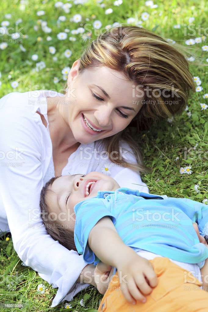 Mother with her son playing together outdoor royalty-free stock photo