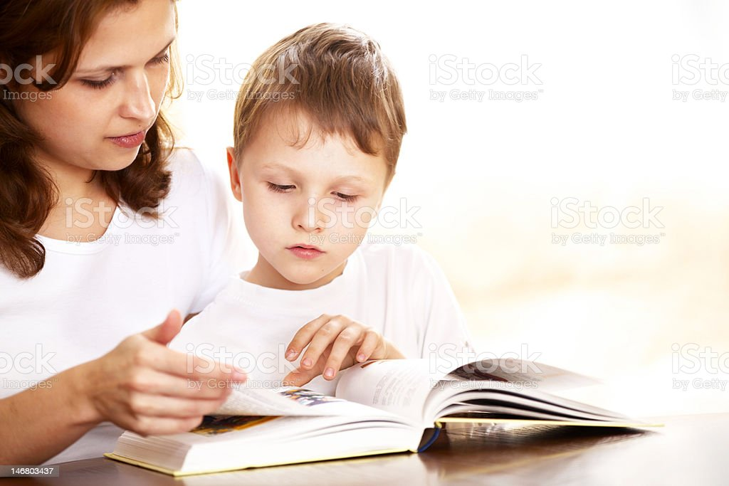 mother with her son reading royalty-free stock photo