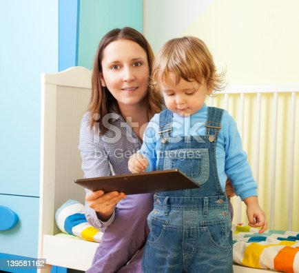 istock Mother with kid and tablet computer 139581162