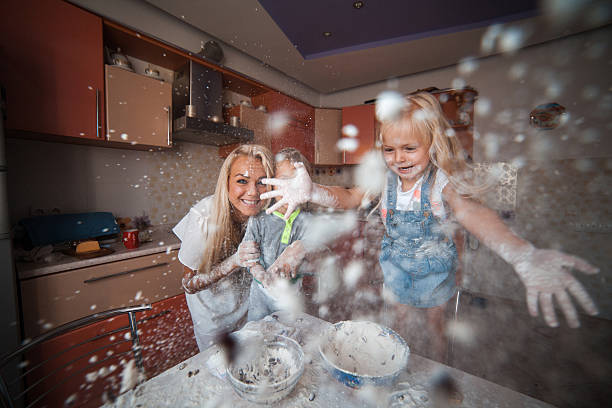 Mother with kids on kitchen stock photo