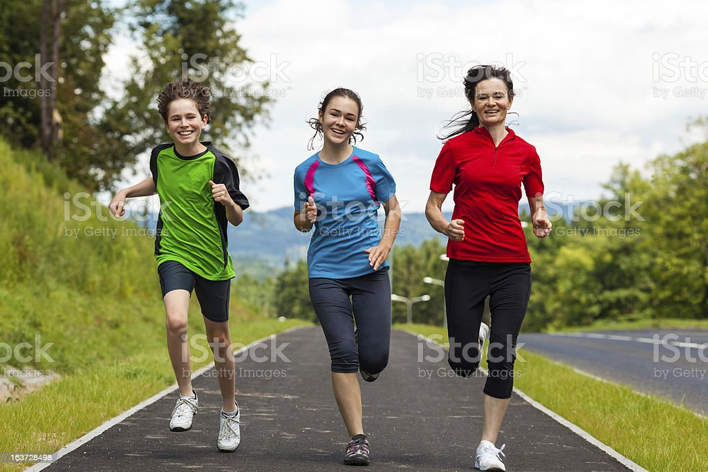 Mother with kids running outdoor stock photo