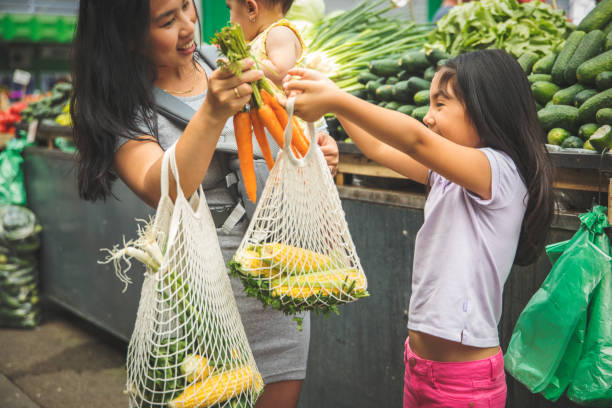 Mother with kids shopping in market Asian mother with kids shopping in market fresh foods asian market stock pictures, royalty-free photos & images