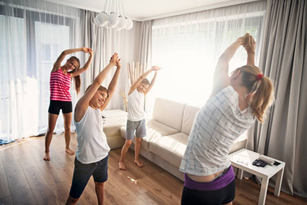 Mother with kids stretching at home stock photo