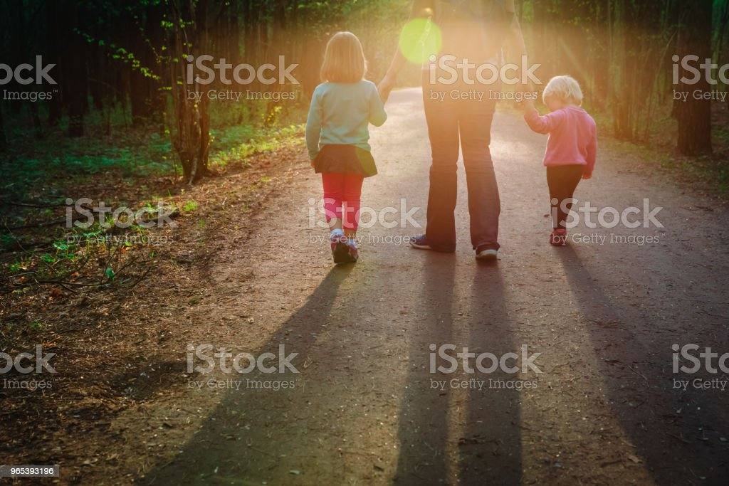 mother with kids walking in sunset nature royalty-free stock photo