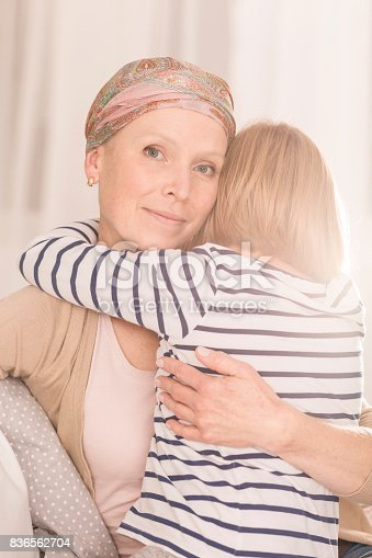 637119208 istock photo Mother with leukemia hugging child 836562704