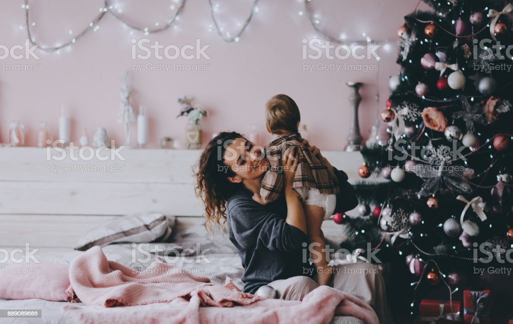 Mother with litlle daughter. Christmas mood. stock photo