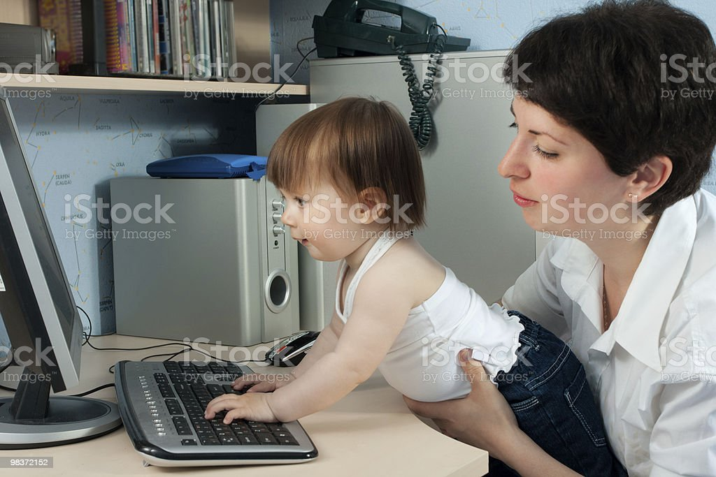 mother with little daughter working on computer royalty-free stock photo