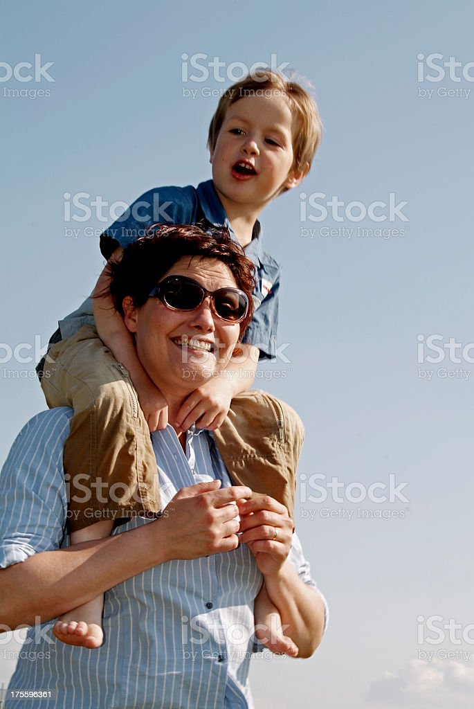 Mother with  little son on her shoulders royalty-free stock photo