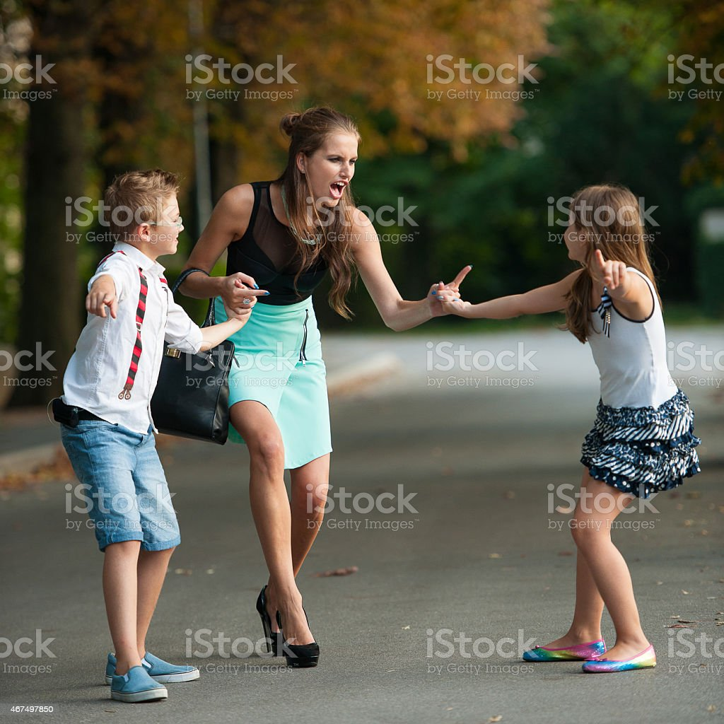 Mother with naughti son adn daughter in park stock photo