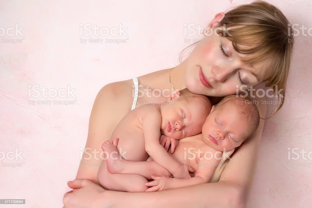 Mother with newborn baby twins stock photo