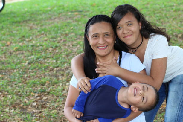 Mother with son and daughter in the park stock photo