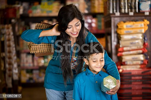 istock Mother with son at supermarket 1213522817