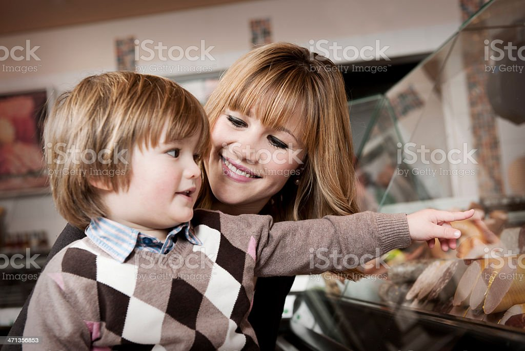 Mother with son in butchers shop royalty-free stock photo