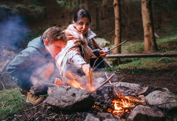 Mother with son make campfire stock photo