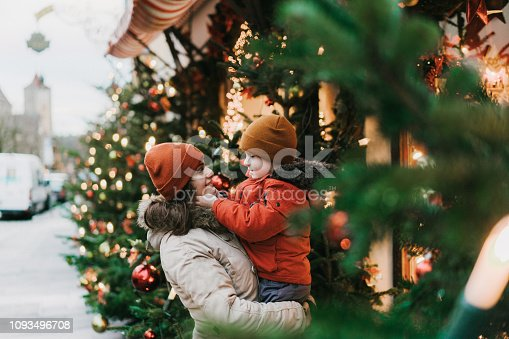 Caucasian mother with preschool son  standing near Christmas tree in Rothenburg