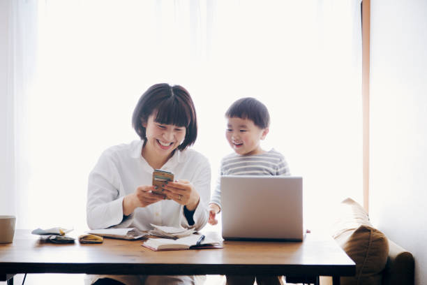 Mother with son working at home stock photo