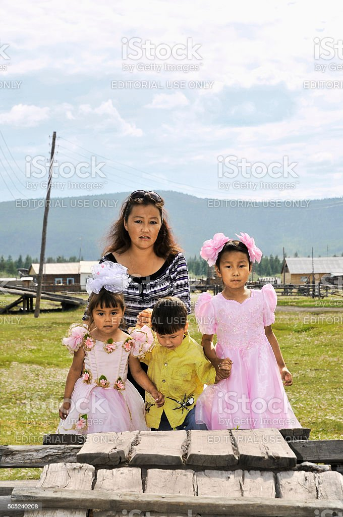 Mother with the children in the Yakut village Oymyakon stock photo
