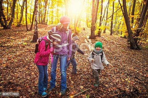 istock Mother with three kids having fun in autumn forest 603277652