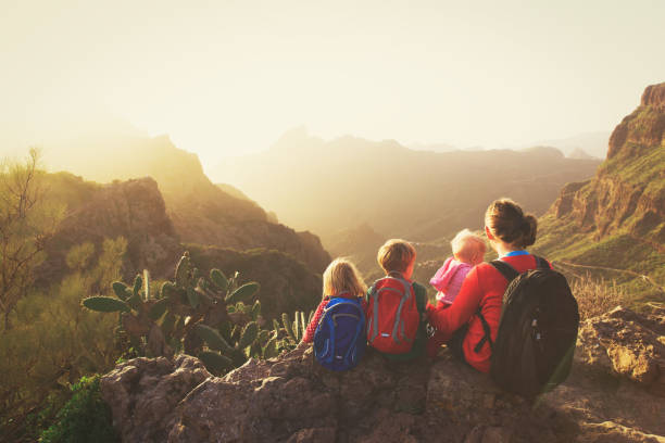 mother with three kids hiking in mountains - teneriffa urlaub stock-fotos und bilder