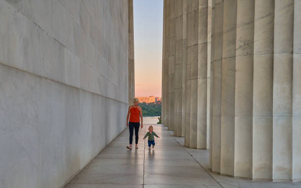 Mother with Toddler Daughter at the Lincoln Memorial at Sunrise in Washington DC Capital of the USA stock photo