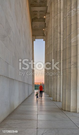 Mother with Toddler Daughter at the Lincoln Memorial at Sunrise in Washington DC Capital of the USA