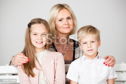 172407626 istock photo Mother With Two Children 180832666