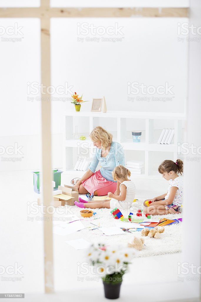 Mother Working At Home with Children. royalty-free stock photo