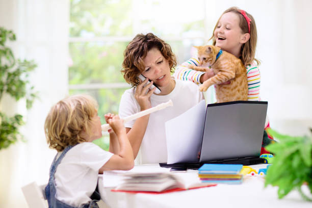 Mother working from home with kids. Quarantine. stock photo