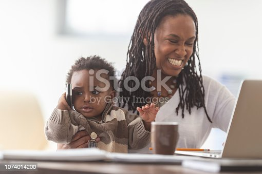 istock A mother works from home with her young son 1074014200