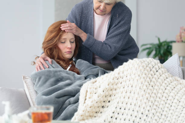 Mother worried about sick daughter stock photo