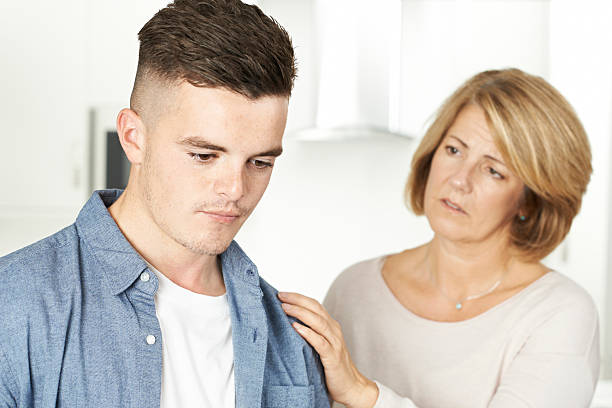 Mother Worried About Unhappy Teenage Son Mother Worried About Unhappy Teenage Son 18 19 years stock pictures, royalty-free photos & images