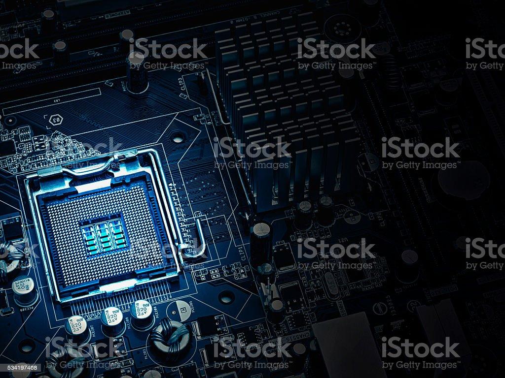 PC motherboard closeup, blue tone stock photo