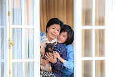 istock Mother,daughter and puppy chihuahua at the window 467651718