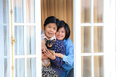 istock Mother,daughter and puppy chihuahua at the window 467651720