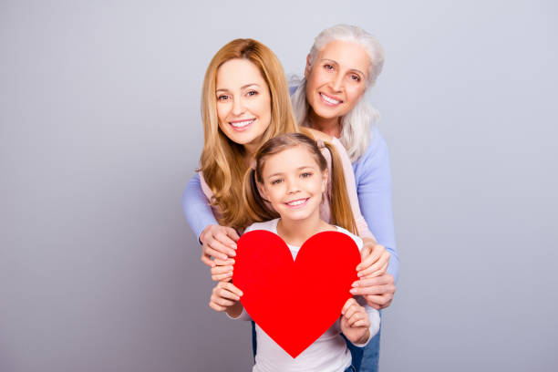motherhood relationship maternity loveliness tenderness cute blonde-haired parenthood generation concept. beautiful cheerful excited granny mom kid holding one big heart isolated on gray background - little girls giving head stock photos and pictures