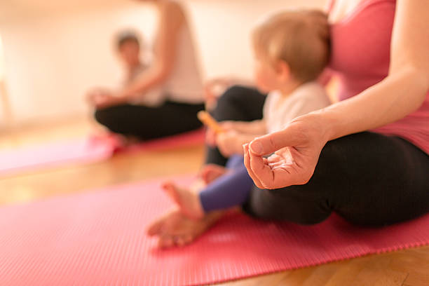 Mothers and babies meditating stock photo
