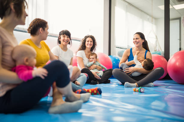 Mothers and babies on exercise class with a instructor stock photo