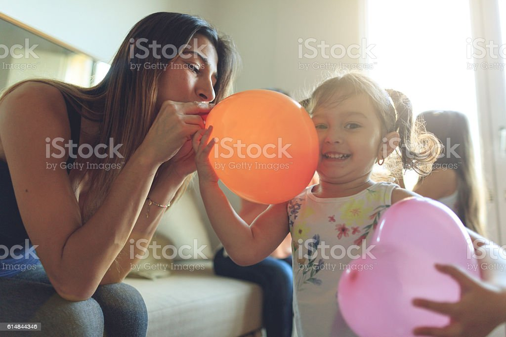 Mothers and daughters having fun together at home stock photo