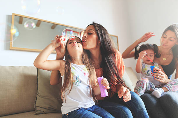 Mothers and daughters having fun together at home - foto de acervo