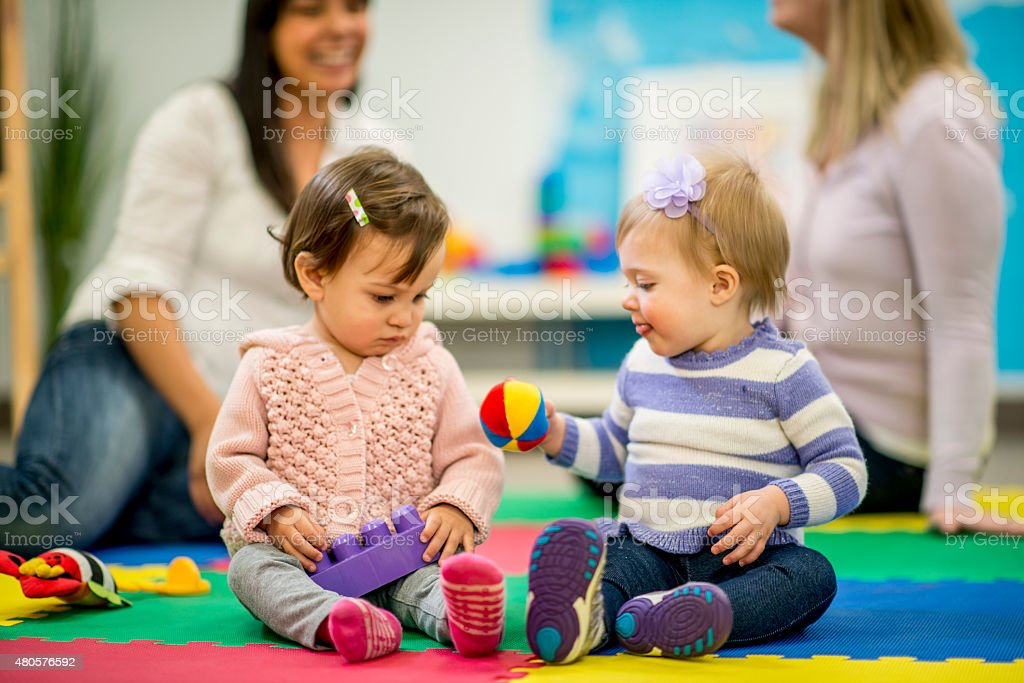 Mothers and their Baby Daughters stock photo