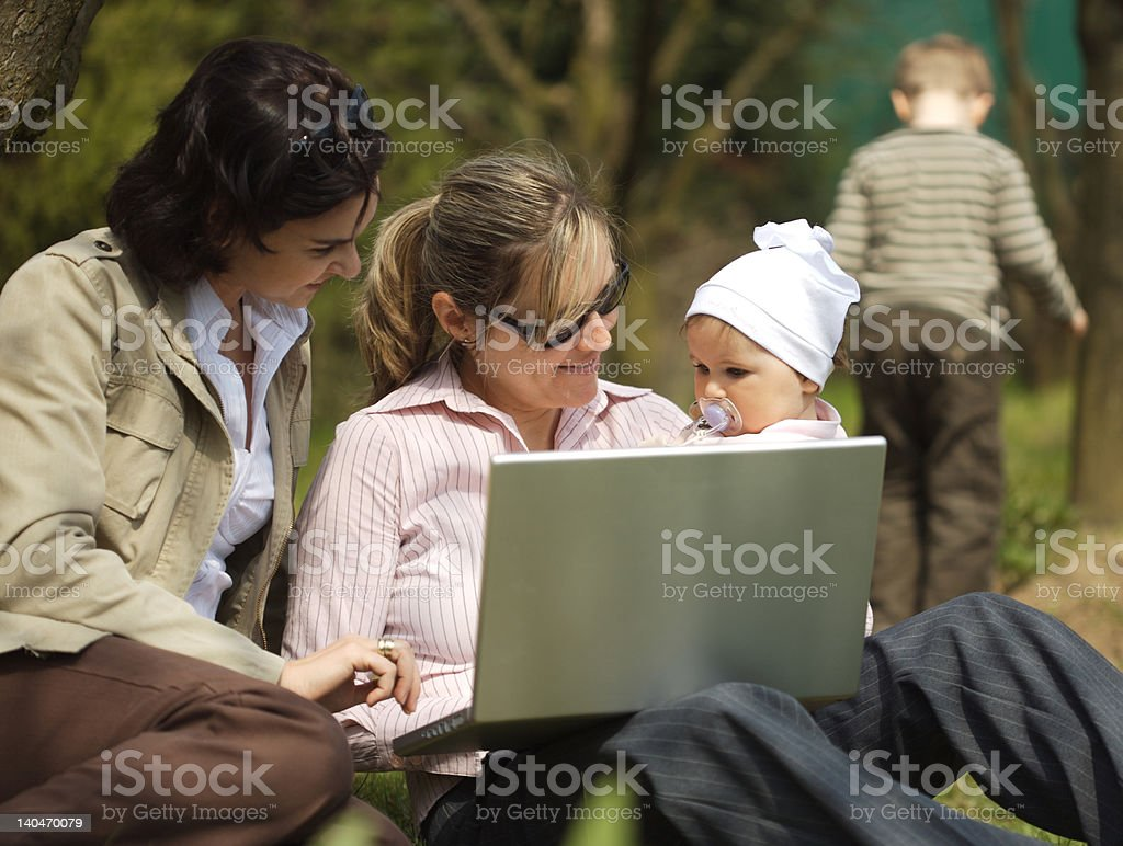 Mothers are using laptop royalty-free stock photo