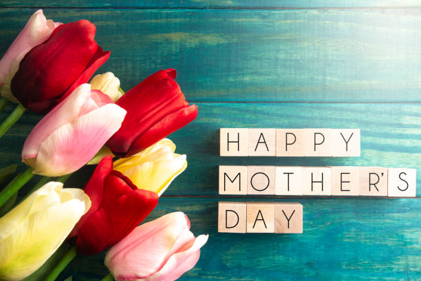A Mothers Day Background with Multicolored Spring Tulips A Mothers Day Background with Multicolored Spring Tulips verbaasd stock pictures, royalty-free photos & images