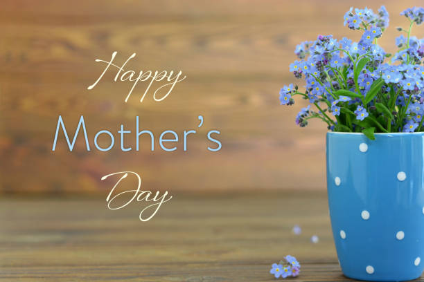 mothers day card with flowers in the cup on wooden background - mothers day stock pictures, royalty-free photos & images