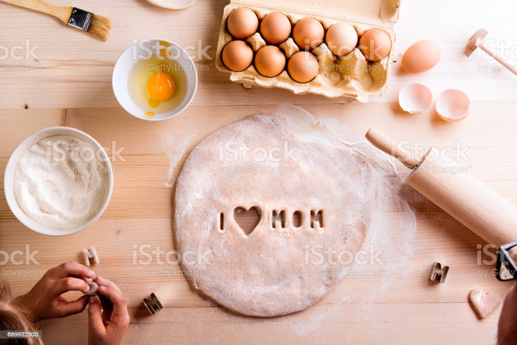 Mothers day composition. Baking cookies. Studio shot. stock photo
