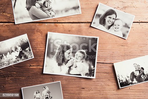 istock Mothers day composition. Black-and-white pictures, wooden backgr 525959168