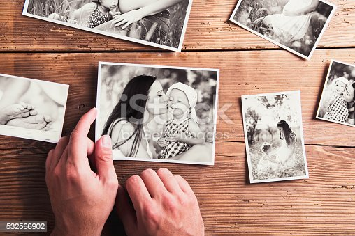 istock Mothers day composition. Black-and-white pictures, wooden backgr 532566902