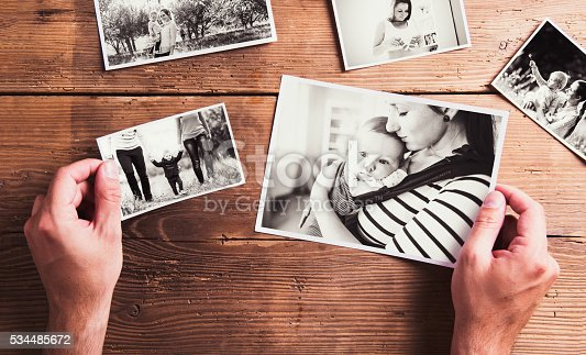 istock Mothers day composition. Black-and-white pictures, wooden backgr 534485672