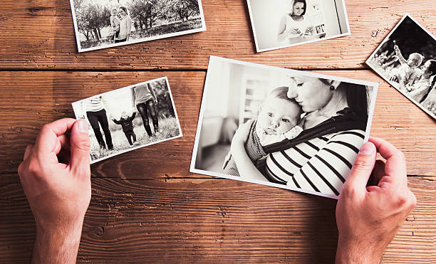 Mothers day composition. Black-and-white pictures, wooden backgr stock photo