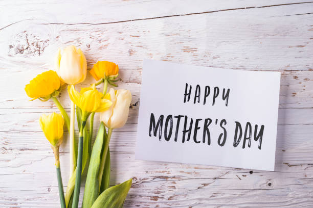 mothers day composition. note and flowers. studio shot. - happy mothers day type stock photos and pictures